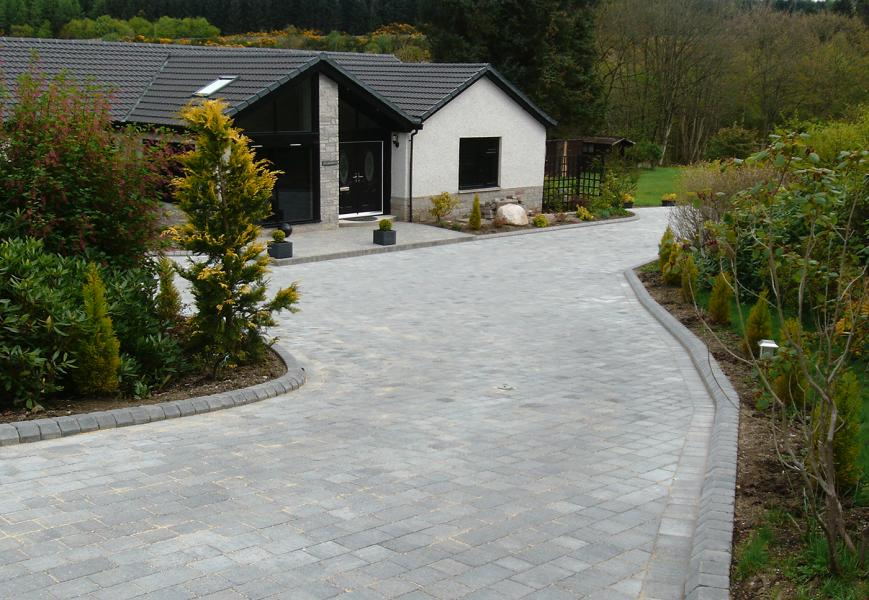 Large paved driveway with matching edging